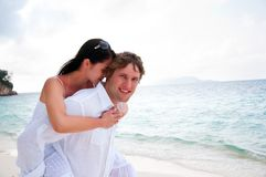 Couple in love enjoying a summer holiday. Royalty Free Stock Images