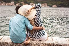 Couple enjoying the summer time by the sea. Couple in love, enjoying the summer time by the sea royalty free stock photography