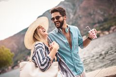 Couple enjoying the summer time by the sea. Couple in love, enjoying the summer time by the sea royalty free stock image