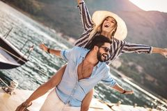 Couple enjoying the summer time by the sea. Couple in love, enjoying the summer time by the sea stock photography