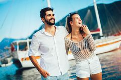 Couple enjoying the summer time by the sea royalty free stock photography