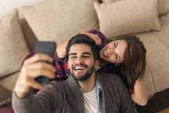 Couple taking a selfie royalty free stock photos