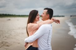 Couple walking on beach. Man and woman on sand royalty free stock images