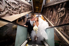 A couple in love, on the escalator at the Mall. Stock Photo