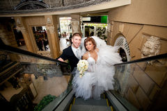 A couple in love, on the escalator at the Mall. Royalty Free Stock Photo