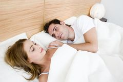Couple Love Expression. Young couple in the bed and the man is admiring the women Royalty Free Stock Photography