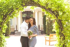 Couple in love are facing each other on the day of the holy vale. Ntine, the guy gives a bouquet Stock Photography