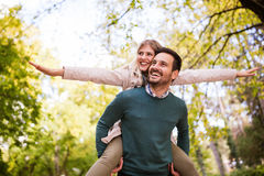 Couple in love feeling happy outdoors Stock Images