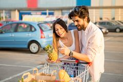 A loving couple in front of the shopping center stock photo