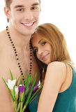Couple in love with flowers Stock Photography