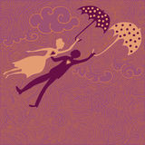 Couple in love flying with umbrellas. Flying couple in love with dotted umbrellas Royalty Free Stock Photography