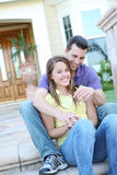 Couple in Love in Front of Home royalty free stock image