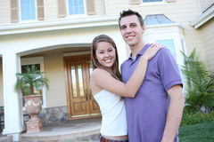 Couple in Love in Front of Home royalty free stock photography