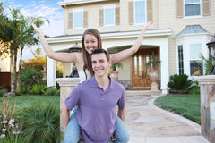 Couple in Love in Front of Home Stock Images