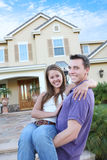 Couple in Love in Front Home (Focus on Woman) Stock Images