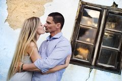 Couple in love in front of an old house Stock Images