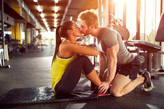 Couple in love in gym Royalty Free Stock Image