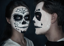 Couple in love with Halloween face art Stock Photography