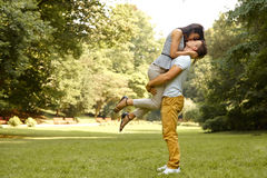 Couple in Love. Happy couple kissing in the park. Royalty Free Stock Photos