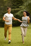 Couple in Love. Happy Couple Running in the park Stock Image