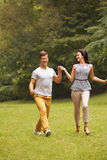 Couple in Love. Happy Couple Running in the park Stock Photography