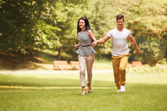Couple in Love. Happy Couple Running in the park Royalty Free Stock Images