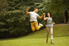 Couple in Love. Happy Couple Running in the park Stock Photo