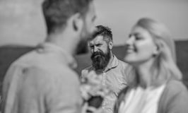Couple in love happy dating, jealous bearded man watching wife cheating him with lover. Lovers meeting outdoor flirt. Couple in love happy dating, jealous stock image