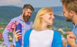Couple in love happy dating, jealous bearded man watching wife cheating him with lover. Lovers meeting outdoor flirt. Couple in love happy dating, jealous stock images