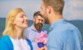 Couple in love happy dating, jealous bearded man watching wife cheating him with lover. Lovers meeting outdoor flirt royalty free stock photos