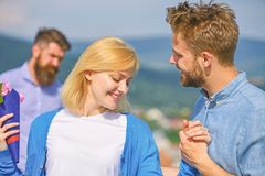 Couple in love happy dating, jealous bearded man watching wife cheating him with lover. Lovers meeting outdoor flirt. Romance relations. Couple romantic date stock photo