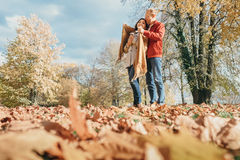 Couple in love have a romantic time in autumn park Royalty Free Stock Photos