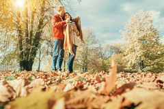 Couple in love have a romantic time in autumn park Royalty Free Stock Image