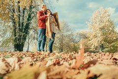 Couple in love have a romantic time in autumn park Royalty Free Stock Photography