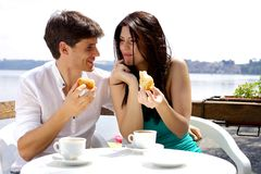Couple in love having breakfast in front of lake in vacation Royalty Free Stock Image