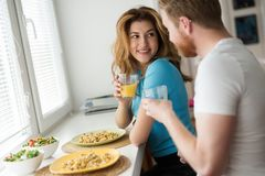 Couple in love having breakfast at home. Romantic couple in love having breakfast at home Royalty Free Stock Photo