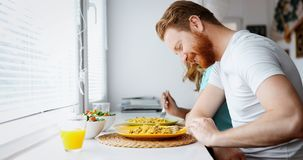 Couple in love having breakfast at home. Romantic couple in love having breakfast at home Royalty Free Stock Photography