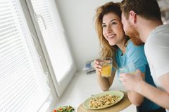 Couple in love having breakfast at home. Romantic couple in love having breakfast at home Royalty Free Stock Images
