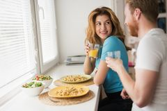 Couple in love having breakfast at home. Romantic couple in love having breakfast at home Royalty Free Stock Image