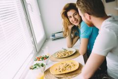 Couple in love having breakfast at home. Romantic couple in love having breakfast at home Stock Photography