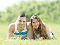 Couple in love having date on grass Stock Photography