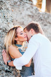 Couple in love having fun on amazing paradise tropical beach .Sexy model and her handsome man enjoying summer time . Stock Images