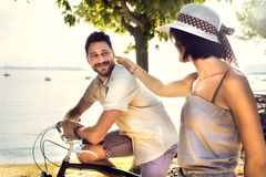 Couple in love having fun by bike on holiday to the lake royalty free stock photos