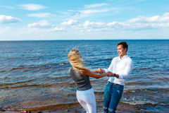 Couple in love having fun laughing and smiling at beach Royalty Free Stock Photography