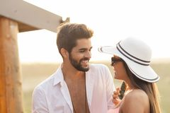 Couple at a summertime pool party. Couple in love having fun at an outdoor summertime party royalty free stock images