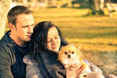 Couple in love having fun with their dog at park - Young people Stock Photos