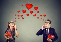 Couple in love having romantic telephone conversation Stock Images