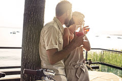 Couple in love having spritz time with lake view Royalty Free Stock Images