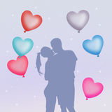 Couple in love with hearts balloons Royalty Free Stock Image