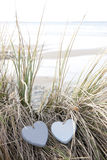 Couple of love hearts on sand dunes in summer Stock Photos